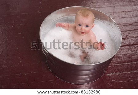 6 month old boy bathing in a galvanized tub infant bubble bath stock photo 83132980 shutterstock. Black Bedroom Furniture Sets. Home Design Ideas