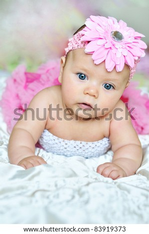 3 months old baby wearing pink beautiful clothes