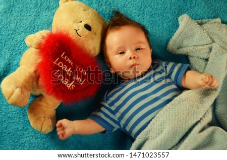 "3 months old boy in blue striped football on a blue background with a Teddy bear with heart: ""love you loads and loads"" #1471023557"
