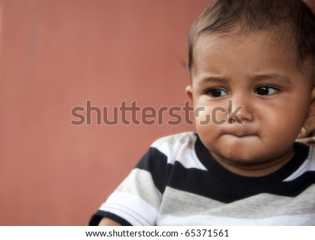 7 months old Indian origin asian baby boy kid thinking deeply.