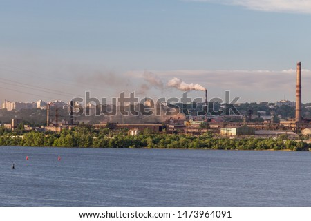 Morning, industrial landscape, industrial enterprise on the river bank