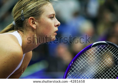 MOSCOW - OCTOBER 14:  Russia's Maria Sharapova in the quarterfinal game of the Kremlin Cup tennis tournament on October 14, 2005 in Moscow. - stock photo