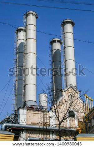 2010.04.11, Moscow, Russia. Factory pipes on background of blue sky. Concept of pollution atmosphere.  #1400980043