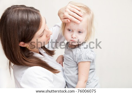 mother is holding a sick daughter in her arms