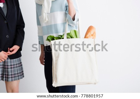 Mother with high school girls and eco bag #778801957