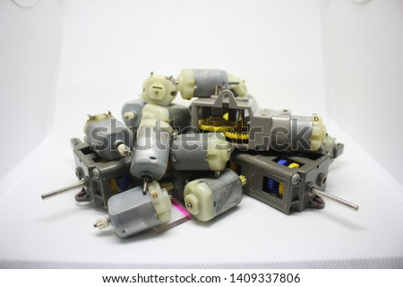 Motor and gear on the White Blackground. electric motor (DC 3V motor Rotor)  DC Motor in Hobby Toy. #1409337806