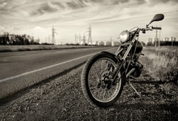 Motorbike.Road and city with open sky on background.Vintage effect added