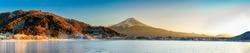ฺMountain Fuji in panoramic atmosphere in the beautiful sunset with the cold air that freezes the lake
