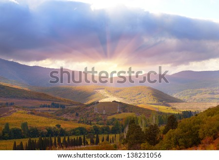 Mountain landscape with sun and clouds