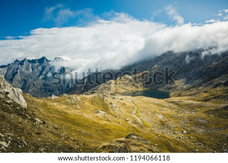 Mountainous panorma landscape view with big mountains. Mountain Pass in Switzerland. Autumn mood at Grimsel Pass. The pass road runs through a wild #1194066118