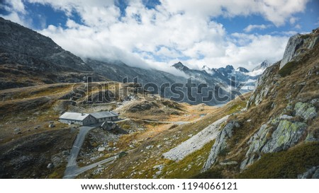 Mountainous panorma landscape view with big mountains. Mountain Pass in Switzerland. Autumn mood at Grimsel Pass. The pass road runs through a wild #1194066121