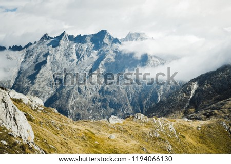 Mountainous panorma landscape view with big mountains. Mountain Pass in Switzerland. Autumn mood at Grimsel Pass. The pass road runs through a wild #1194066130
