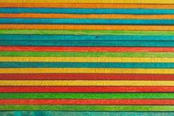 multi colored wooden sticks, colorful bakcground