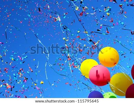 multicolored balloons and confetti in the city festival #6