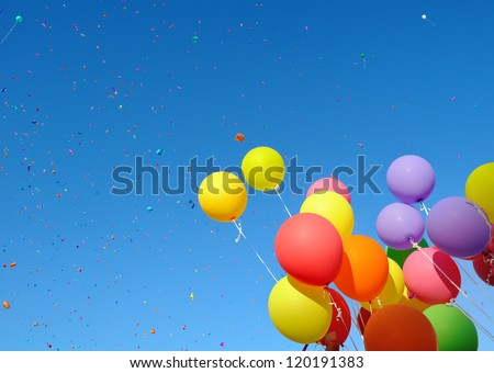 multicolored balloons and confetti in the city festival#7