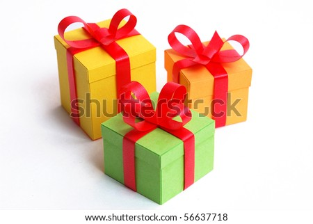 3 multicolored presents with red bowknot