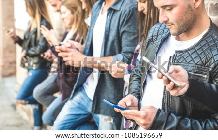 Multicultural friends group using smartphone at university college break - Millenial people hands addicted by mobile smart phones - Technology concept with always connected millennials - Filter image