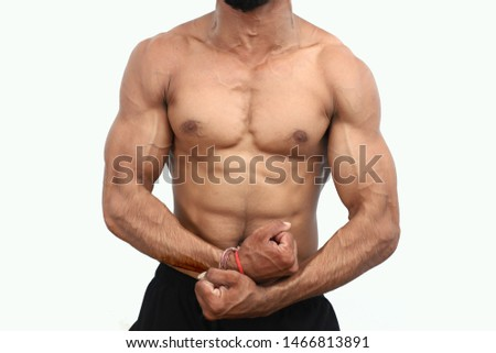 Muscular And Fit Torso Of Young Man Having Perfect Abs, Bicep And Chest