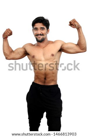 Muscular And Fit Torso Of Young Man Having Perfect Abs, Bicep And Chest.