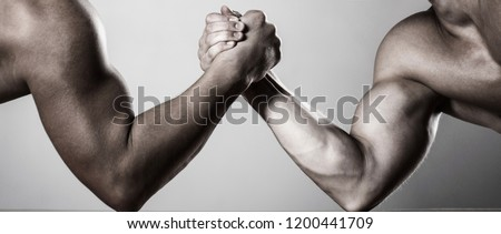 Muscular hand. Arm wrestling. Two men arm wrestling. Rivalry, closeup of male arm wrestling. Two hands. Men measuring forces, arms. Hand wrestling, compete. Hands or arms of man. Black and white.