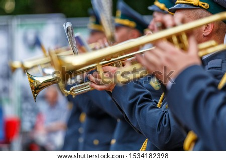 Music instrument played by saxophonist player and band musicians on stage in fest, at a concert musician playing his instrument,tuba brass instrument, wind classical musician . #1534182398