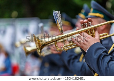 Music instrument played by saxophonist player and band musicians on stage in fest, at a concert musician playing his instrument,tuba brass instrument, wind classical musician . #1534182401