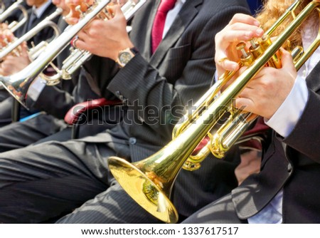 musicians play wind instruments #1337617517