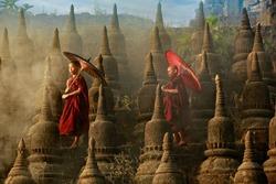 [MYANMAR] Buddhist novice monk are walking in pagoda,myanmar
