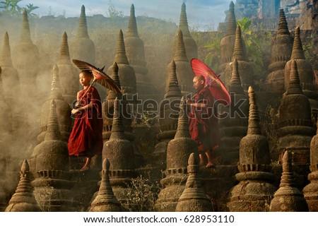 Photo of  [MYANMAR] Buddhist novice monk are walking in pagoda,myanmar