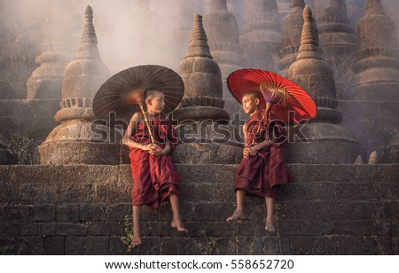 [MYANMAR] little monks,  stay outdoors pagoda background,