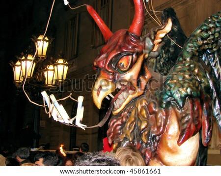 mystical figure of a devil on celebratory procession San Juan in barcelona, spain