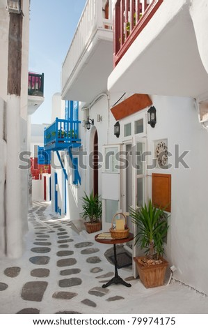 Narrow streets of the Greek with balconies and flowers ...