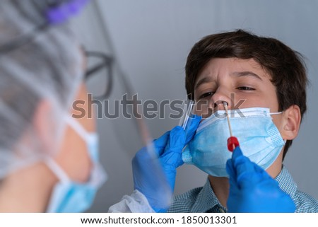 Nasal swab taken from a patient.Coronavirus testing ストックフォト ©
