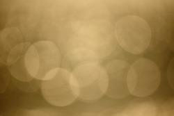 Natural photo bokeh background, defocused brown lights