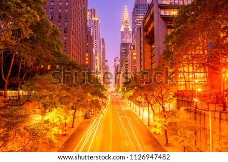42nd street, Manhattan viewed from Tudor City Overpass at night featuring car light trails on the foreground  Stock fotó ©