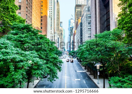 42nd street, Manhattan viewed from Tudor City Overpass with Chrysler Building in background in New York City during sunny summer daytime at sunset Stock fotó ©