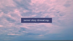 Never stop dreaming with red cloudy sky background