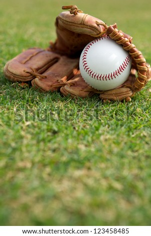 New baseball in a glove with room for copy