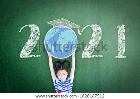 2021 new educational academic calendar year for school class with student kid raising world global planet on teacher's green chalkboard for back to school celebration, classroom schedule concept