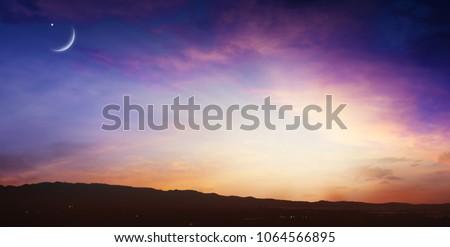new moon .  Prayer time . Generous Ramadan .  Mubarak background . Sunset or sunrise with clouds .
