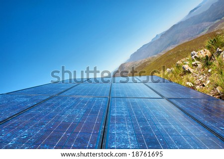 'New sky' - blue solar cells and awesome mountain landscape as a background. Shot in Salmonsdam Nature Reserve, near Hermanus/Stanford, Western Cape, South Africa.