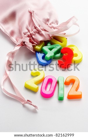 2012 new year and colorful plastic alphabet blocks in sachet