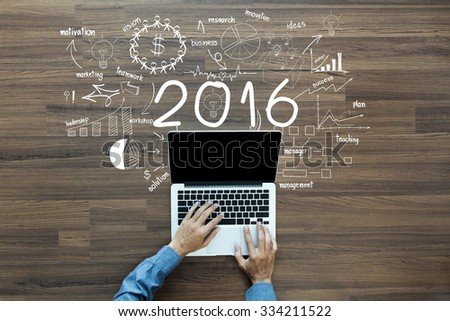 2016 new year business success, Creative thinking drawing charts and graphs strategy plan ideas wooden table background, Inspiration concept with businessman working on laptop computer PC, Top View #334211522