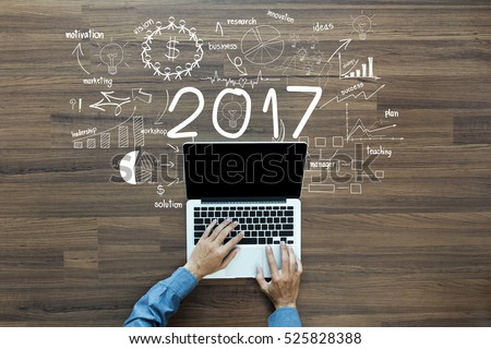 2017 new year business success, Creative thinking drawing charts and graphs strategy plan ideas wooden table background, Inspiration concept with businessman working on laptop computer PC, Top View #525828388