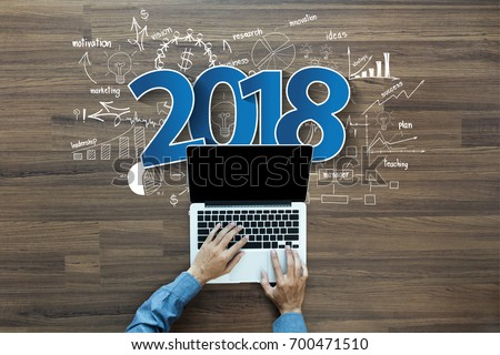 2018 new year business success, Creative thinking drawing charts and graphs strategy plan ideas wooden table background, Inspiration concept with businessman working on laptop computer PC, Top View #700471510