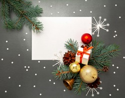 2021 New Year Christmas decorations flatlay. Gift box ribbon golden balls spruce branch pinecone bell snowflakes top view. Boxing Day banner template black white paper copy space. Xmas concept mock up