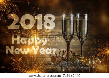 2018 New Year concept, Glasses of champagne with sparkler on background #719162440