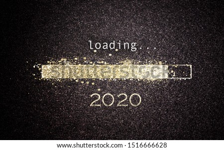 2020 New Year concept with a gold glitter bar loading on a black screen with date as a greeting card design for the holiday season