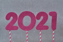 2021 new year. Date, numbers of bright magenta color on a silver background with effects bokeh. Creativity, new year concept.