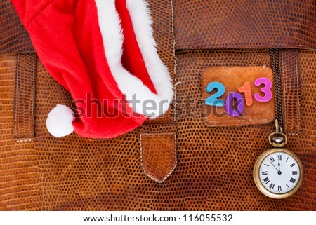2013 New Year date, red Santa cap and pocket watch on vintage leather textured background